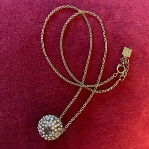 Gold necklace with crystal ball